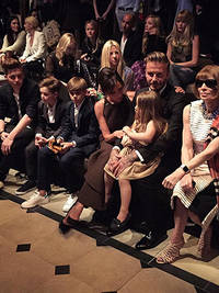 The Beckhams at Burberry! Victoria and David dote on Harper as they sit front row with Anna Wintour